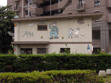 川口神社近くの交番の壁画